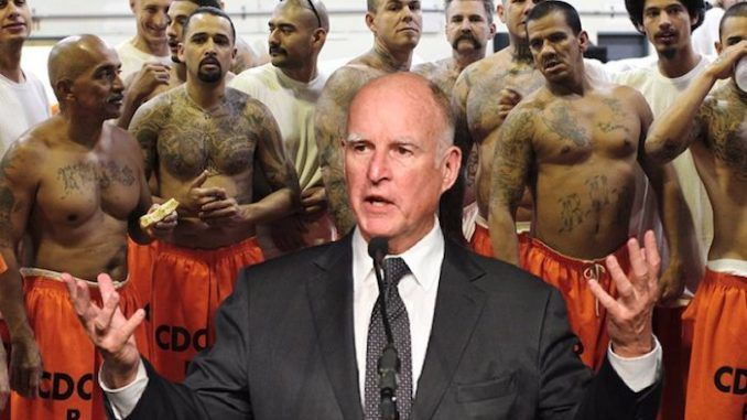 California Gov. Jerry Brown has pardoned a refugee convicted of murder and robbery charges, as well as a Democrat former state senator convicted of felony voter fraud.