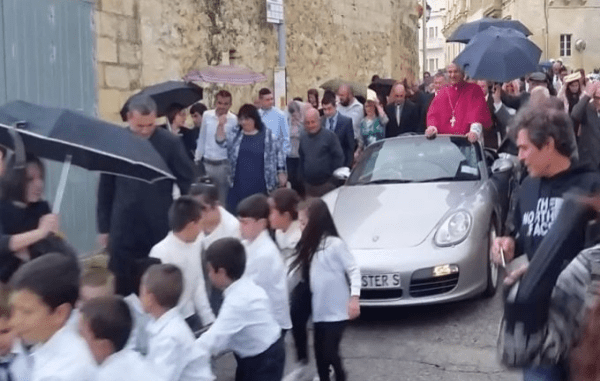 Catholic Priest Paraded Through Town In Convertible Porsche Pulled By Children
