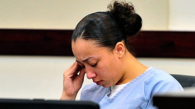 The Tennessee Supreme Court has ruled that a woman who killed a man in self-defense when she was a child sex slave must serve more than 50 years in prison before she is eligible for parole.