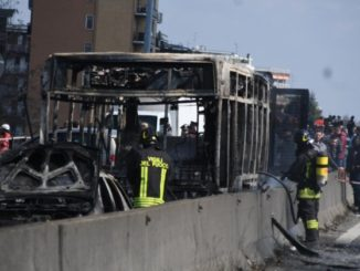 Migrant sets fire to bus full of children