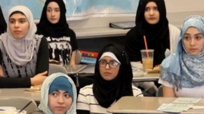 A school in Frankfurt, Germany has come under fire after its principal told a young girl she should deny her German nationality and wear a hijab if she doesn't want to get bullied.