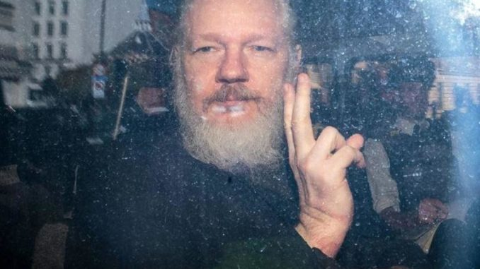 Julian Assange becomes first journalist to be charged under U.S. espionage act