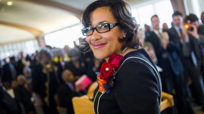 Flint's Mayor Karen Weaver has been accused of using the water crisis for personal gain by re-directing donations to a political fund.