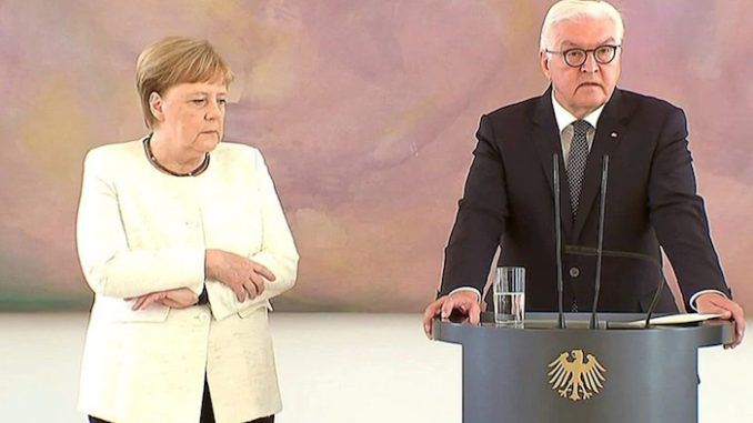 German Chancellor Angela Merkel caught violently shaking during ceremony
