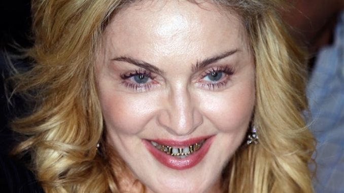 "The lack of gun control in America as ""frightening"" and a ""huge, huge problem"" according to Madonna, who told a Reuters journalist that she personally finds it ""pretty scary""."