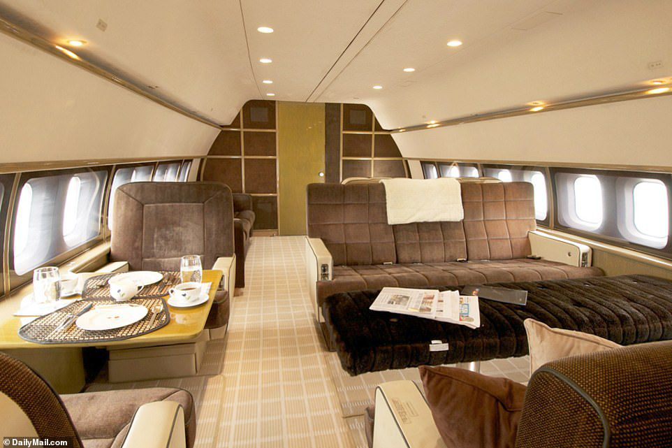 The luxury aircraft built in 1969 has been modernized and boasts plush furnishing and recessed lighting in these exclusive shots. Our photos also show a circular shaped lounge filled with beige comfy chairs (pictured)