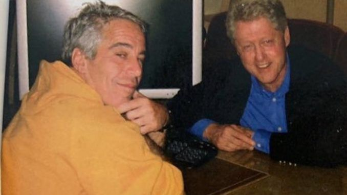A newly resurfaced photograph taken in 2002 shows U.S. President Bill Clinton with billionaire pedophile Jeffrey Epstein.