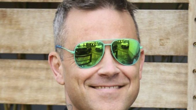Robbie Williams installs 24-hour security at his home over fears aliens might contact him