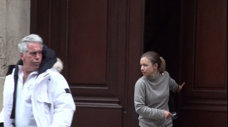 Following him, a young blonde-haired woman with a ponytail emerges from behind the imposing Manhattan home's 15ft-high oak doors in a flimsy grey sweater