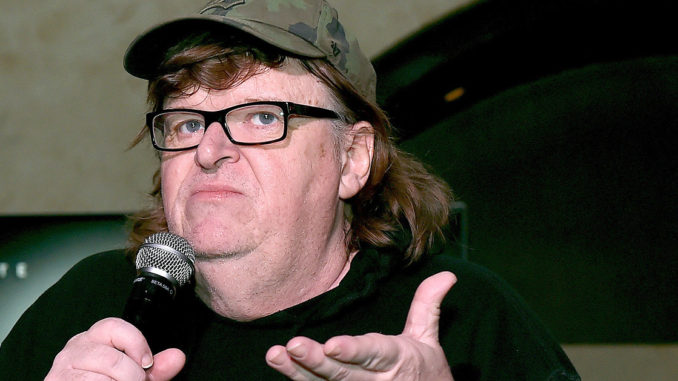 """Michael Moore has urged Michelle Obama to run for the 2020 Democratic presidential nomination, claiming she can """"crush"""" President Trump."""