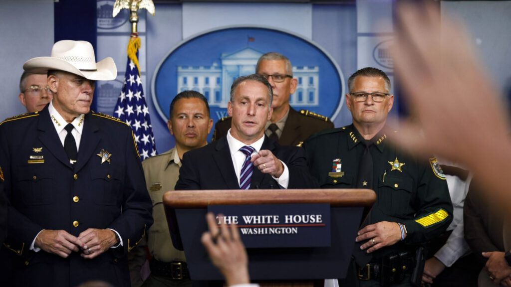 Acting Director of U.S. Immigration and Customs Enforcement Matthew Albence, joined by members of law enforcement, speaks during a news conference at the White House in Washington, Thursday, Sept. 26, 2019.