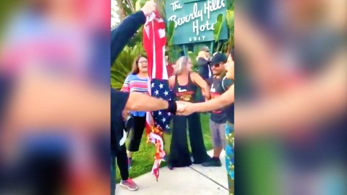 Anti-Trump protestors burned an American flag amid the arrival of President Donald Trump in Los Angeles for a fundraising event.