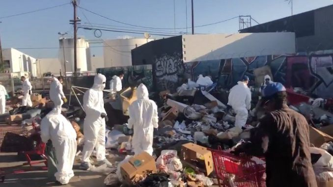 Conservative activists have cleaned up 50 tons of garbage at a homeless camp in Los Angeles during a nine-hour shift on Saturday.