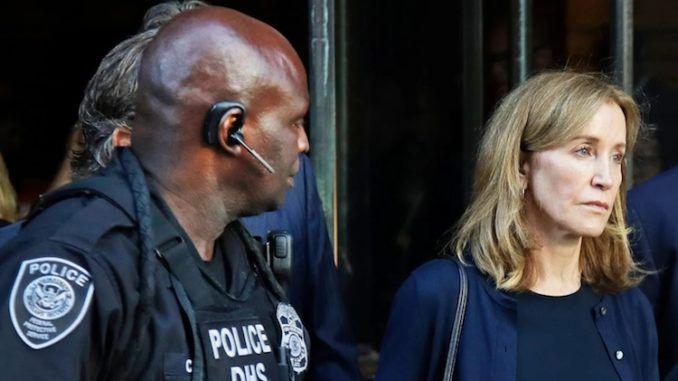 Felicity Huffman jailed in college admissions scandal