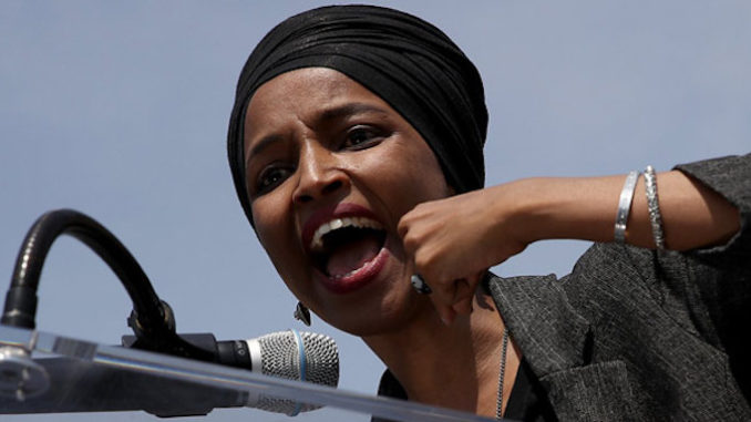 """Rep. Ilhan Omar has blamed """"political opponents and the media"""" for placing a """"significant toll"""" on her marriage, according to a statement issued by her lawyer on her behalf."""