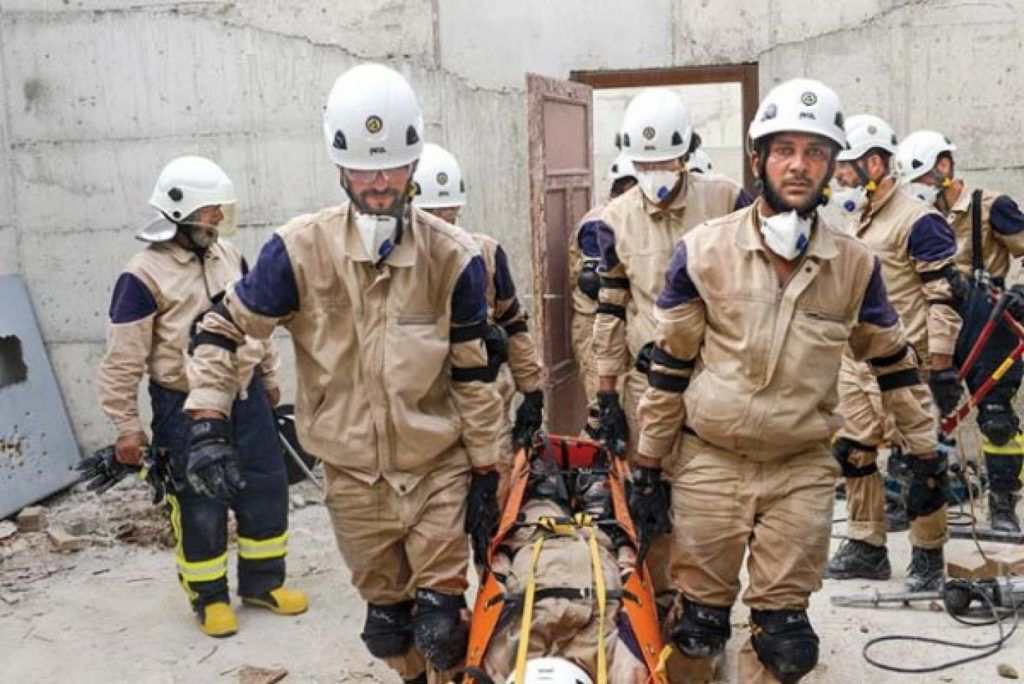 This original report, if it had been published as written, would not have supported widespread claims that poison gas was used at Douma on April 7, 2018. If any such gas was used, it was not a gas known to, or detected by the scientists who visited the scene, examined the buildings and soil and carefully checked the samples. (Above, White Helmets members in action at the site of the supposed gas attack.)