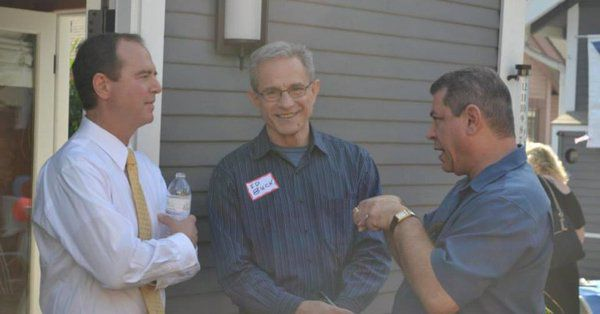 Rep. Adam Schiff and Ed Buck (center) outside a house in California.