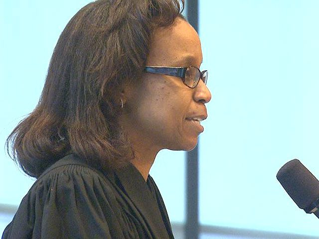"Judge Denise J. Casper told jurors that a ""true threat"" does not include ""caustic"" or ""sharp"" political attacks."