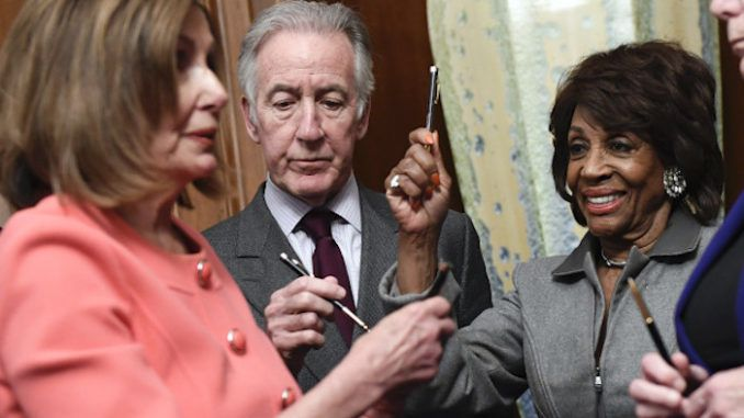Nancy Pelosi uses over a dozen commemorative pens to sign articles of impeachment before handing them out like prizes to fellow Democrats