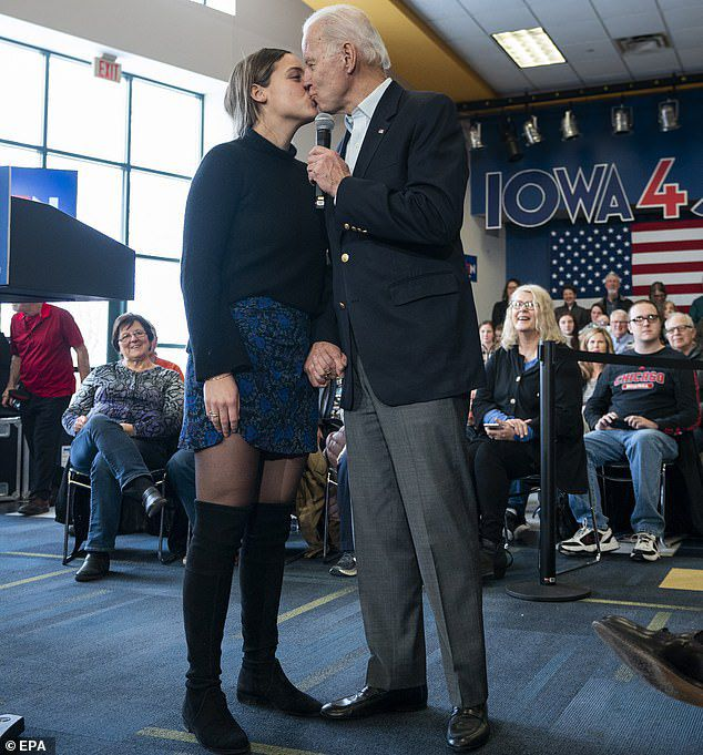 What the... ? Joe Biden gave his 19-year-old granddaughter Finnegan Biden a kiss on the lips while giving a speech at a campaign trail event in Dubuque, Iowa on Sunday