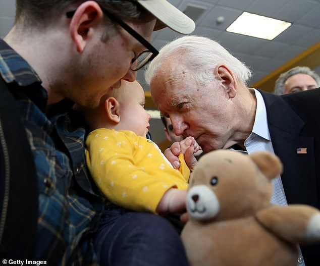 At one point, Biden could be seen interacting with a baby as he kissed the child's hands