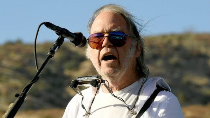 """Far-left rocker Neil Young, who was granted U.S. citizen last month, has attacked President Donald Trump as """"a disgrace to my country"""" and promised that """"we are going to vote you out and Make America Great Again"""" in November."""