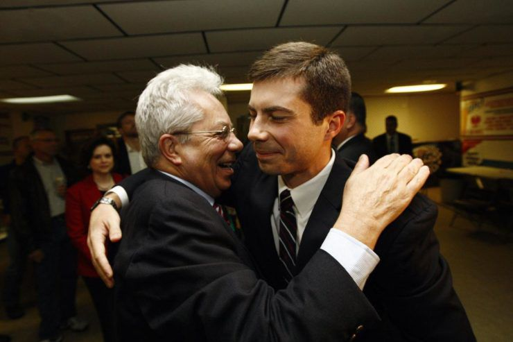 Joseph and Pete Buttigieg embrace during the younger Buttigieg's successful mayoral campaign in South Bend, Indiana
