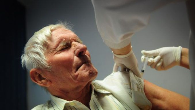 CDC say 13 million Americans ill with flu this season with 18,000 deaths