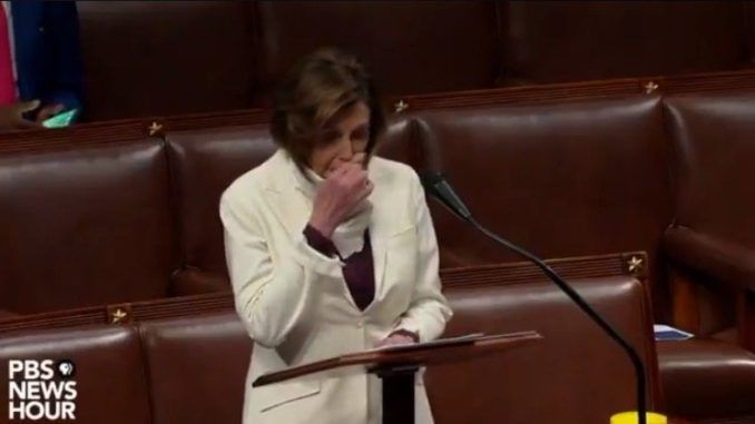 Video shows House Speaker Nancy Pelosi wiping her nose with her bare hand and then wipe it on the shared podium