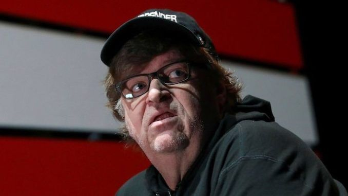 Michael Moore says Minneapolis police HQ should be demolished in tribute to black protestors
