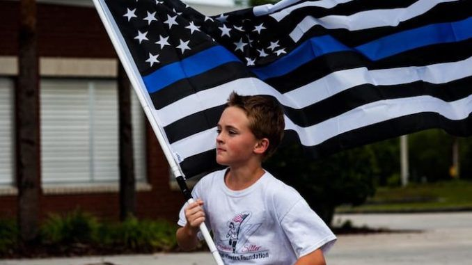 A determined 11-year-old boy has been running a mile for every First Responder that has fallen in the line of duty and donating money to the families of the fallen.