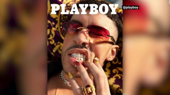 """Playboy have put a """"gender fluid"""" man wearing make up, false nails and a revealing black and gold toga on their cover."""