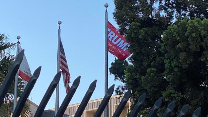 Patriots take down California flag and replace it with Trump campaign banner