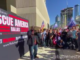 Large crowds gather outside CNN HQ in Atlanta chanting 'CNN sucks'