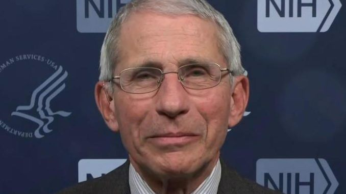 Dr. Anthony Fauci warns Americans may have to wear masks into 2022