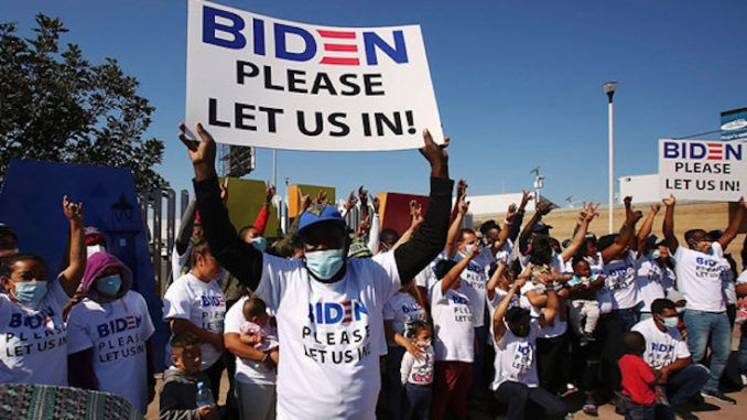 Illegals wearing Biden t shirts flood border begging to be let in
