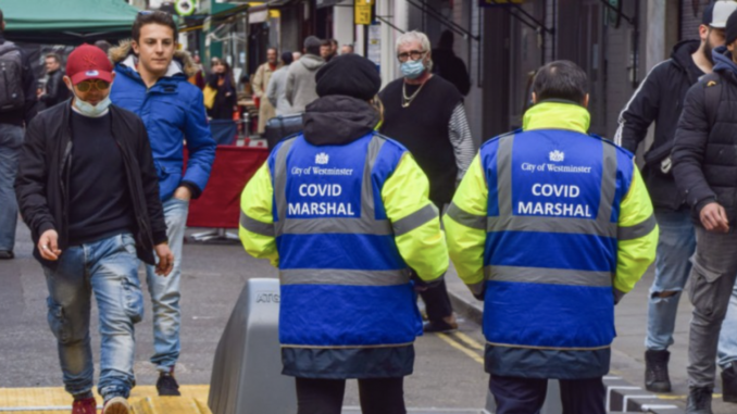 UK government hiring COVID marshals to patrol the streets until 2023