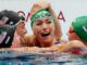 Olympic swimmer with 'glory to god' cap wins gold, smashing world records