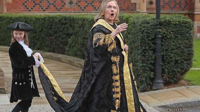 Hillary Clinton was left visibly shaken up during a visit to Queen's University Belfast on Friday, where she was shouted down by an angry crowd.
